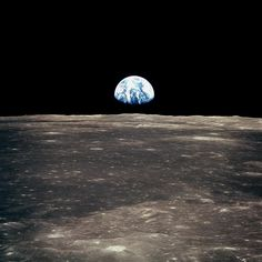 """1969. """"This view from the Apollo 11 spacecraft shows Earth rising above the moon's horizon."""""""