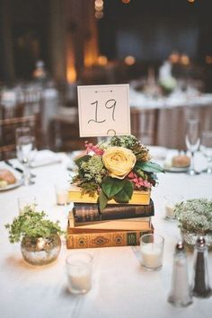 DIY Centerpieces - Books topped with Flowers / http://www.himisspuff.com/rustic-wedding-centerpiece-ideas/3/
