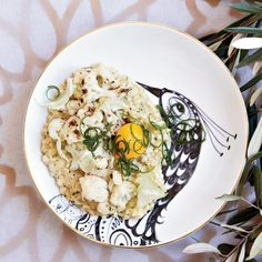 Toasted Farro and Scallions with Cauliflower and Egg | ooking farro like risotto makes it nutty and chewy. It's perfect with golden cauliflower and a runny egg-yolk topping.