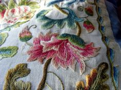 Beautiful crewel work in satin stitch. Pretty soft pastels will look lovely almost anywhere.