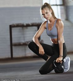 Hot and sweaty: Danish model Josephine Skriver, meanwhile, posed for a duo of shots showing her posing with a kettle bell weight and a gym ball.