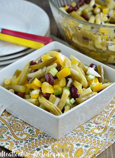 This Easy Three Bean Salad recipe mixes canned green beans, wax beans and kidney beans with a tangy dressing. An easy side salad for spring or summer!