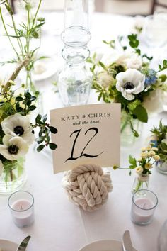 For a nautical wedding...rope knots as table number holders.