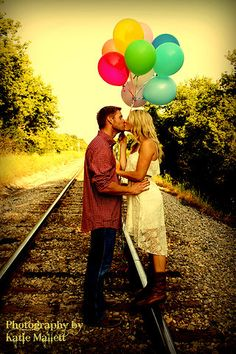 Romantic couple photo at the railroad tracks. Fun props. Balloons. Photography by Katie Mallett. Wedding Photographer in Menomonie, WI and Eau Claire, WI | Portraits  http://katiemallett.wix.com/katiesphotography-