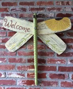 Welcome Home Marty McFly, dragonfly from repurposed ceiling fan blades, table leg and cabinet pulls for eyes. Check out my other dragonflies at www.wingingthis.com