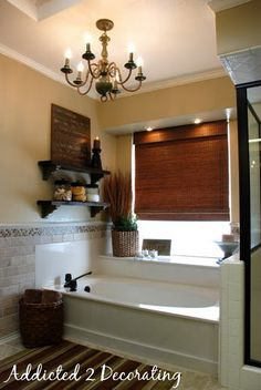 This is EXACTLY the bones of my Master Bathroom, I have been wanting to do something on this empty wall... Needless to say... It was shelves!!! Love the paint color too!!!