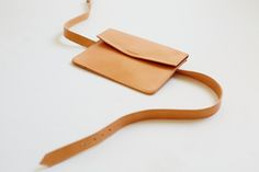 FIO CONVERTIBLE BELT BAGMade in Los Angeles. Vegetable-tanned, bi-product leather sourced from Spain. Bag measures 7 ¼ by 5 inches. Belt measures 37 ½ inches long and will fit waist sizes 30-36. Magnetic closure.