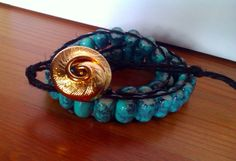 Turquoise Glass Beads with black hemp cord and gold by AnABazaar, $14.99