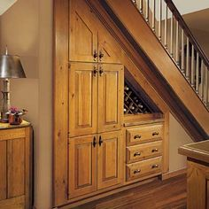 Up~selling with Kitchen Storage Built-Ins clever storage idea Stair-Wall Wine Cellar Unless there's a Boy Wizard bunking under the stairs, chances are the space is being wasted. Make neglected area a stylish focal point where homeowners can store and display their favorite wines.