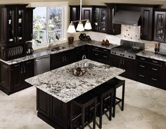 Black cabinets with black and white counter tops -