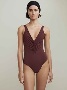 Sondrio is new to the Toteme swimwear family, with a wrinkled V-cut at front and a deeper V-cut at back for a flattering silhouette. In a deep bordeaux red, this luxurious bathing suit will be an essential in your vacation wardrobe this season. [...]Read More...