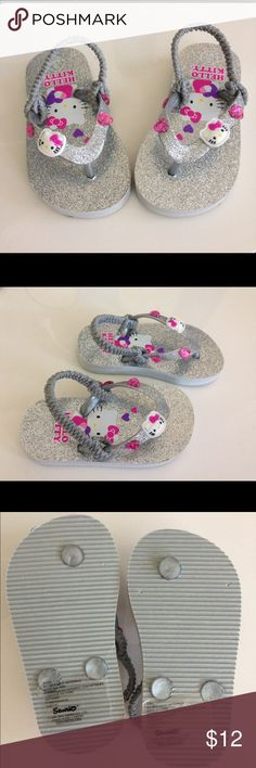 🎉HP🎉Toddler Girls Hello Kitty Flip Flops 🎉Host Pick Everything Kids 11/13🎉 Adorable Hello Kitty Flip Flops in Silver in toddler girls size 5/6. Glittery with heart and kitty detail. They have a thong toe strap and back heel strap. Only wore once- in perfect condition! Hello Kitty Shoes Sandals & Flip Flops