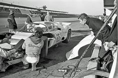Jim Hall (leaning in from the right) guides the crew while the Chaparral 2D receives attention during pre-race practice at Daytona, 1966.