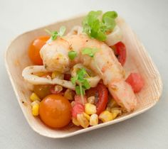 Jonathan Benno's shrimp and calamari with corn, tomatoes, basil, and Calabrian chilies (Photo by Philip Gross)
