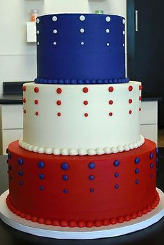 Red, White, and Blue Tower Cake | With a little help from fondant, piping bags, food coloring and lots of fresh berries, you can create a flag cake Betsy Ross would be proud of. Three cheers for the red, white and blue! This Fourth of July, show your patriotic spirit with a stunning cake as the centerpiece of your party. It is the time of year when folks are firing up their BBQ grills and pulling out all the stops for a memorable outdoor party. Whip up a batch of your favorite homemade BBQ
