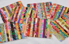 mug rug strip sets cheerful ...have an idea...lay these in sets of 2 and make a diagonal cut, swap top of one for the top of the other, sew a strip onto the cut edge to both sides and double the number of scrap fabrics in each mug rug or placemat.....vwr