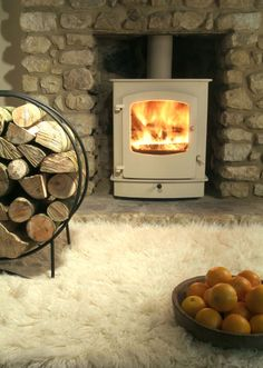 Cream wood burning stove - planning to rip the current fireplace out and hopefully add this! Stove Fireplace, Fireplace Design, Tiled Fireplace, Solid Fuel Stove, Log Burner, Home Comforts, New Living Room, Log Homes, Tiny Homes