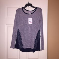 Trixxi Top  NWT Trixxi Top with original tags, never worn. Color is Navy Blue & Gray. Size XS. Pretty blue design in the back. This is more of a flowy top, & the arms are more form fitting. Paid $40, selling for $5  selling because I'm trying to clean out my closet :) Trixxi Tops