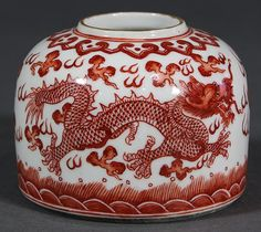 """Chinese Porcelain Brush Washer of dome form decorated with a pair of meandering red dragons in pursuit of a flaming jewel above rolling waves, the mouth encircled by a ruyi band, the base with an apocryphal Guangxu mark, 3""""w"""