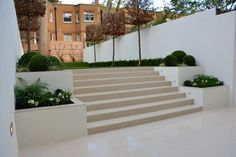 Urban Garden Design Tom Howard Garden Design used Warm Beige Porcelain paving, steps and copings to create this contemporary transition from basement to garden. Sloped Garden, Contemporary Garden Design, Modern Garden Design, Back Garden Design, Garden Stairs