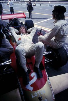 Jochen Rindt and Jackie Stewart chilling.