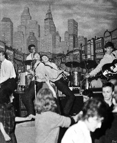 The Beatles at the Star-Club, Hamburg, 1962 - with boogie woogie piano player (and back-up vocalist), Roy Young, from the house band. Brian Epstein asked him to join The Beatles but Young turned them down because he was contracted to the Star Club.
