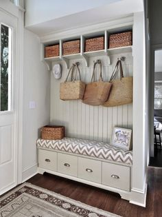 Contemporary Entryway with Oak - Blackened Brown 5 in. Solid Hardwood Wide Plank, Paint, Built-in bookshelf, High ceiling
