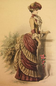 Final phase of the Bustle period: shelflike projection of the skirt, no train, high boned collar, elaborately decorative hat