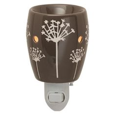 Taro Plug-In Scentsy Warmer - Taro features a contemporary dandelion pattern that pops against a deep gray background. Plug it in and watch it glow!