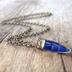 Lapis Lazuli Necklace, Tibetan Horn Charm, Horn Necklace, Lapis Lazuli Inlay Jewelry, Exotic Necklace, Bohemian Jewelry, Black Friday by TesoroDelSol on Etsy https://www.etsy.com/listing/203483692/lapis-lazuli-necklace-tibetan-horn-charm