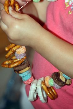 Have them string a movie night snack necklace and then watch a movie!