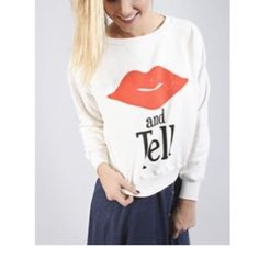 Flash SaleWildfox NWT Kiss and Tell Sweatshirt love this cute design! NWT 'Kiss and Tell' cream colored sweatshirt. so soft and cozy with fleece backed underside. 70% cotton 30% poly. this is NWT but please see photo of stitching near neckline as it is a little uneven looking. size x-small. **just reduced - price firm unless bundled** 6E1559 Wildfox Tops Sweatshirts & Hoodies
