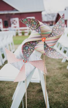 Fun idea! Decorate your aisle chairs with pinwheels. Too cute! #pinwheel #ceremony #wedding #decor #photography Captured by: Bellamint Photography ---> http://bellamintphotographyblog.com/2013/12/30/leona-jeff-crooked-willow-farms-wedding/