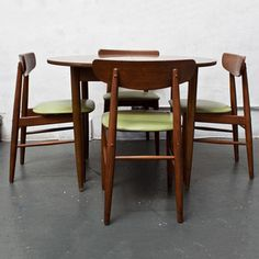 Table With Green Leather Chairs now featured on Fab.