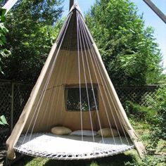 Great example of recycling and DIY. Old canvas tent, trampoline base, add some supports and rope and you have a swinging teepee.