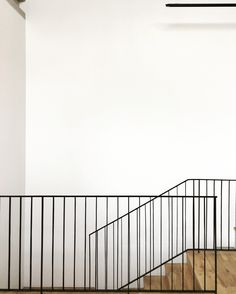 Simplicity with white walls, black steel balustrade and oak timber floors
