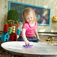 DIY Children's Play Pond - Learn how we converted a water heater drip pan into the perfect place for kids to play with toy boats.