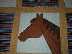 """Quilting: Horse quilt The pattern is called """"Horse Happy"""" and it is from Chickadee Charms. I would google it, but the pattern also has a phone number (307) 683-2907. The horse heads look complicated, but they aren't and it was really fun finding the material to fit each horse. If I remember right, there is also a pattern for a full body horse as well. Happy hunting"""