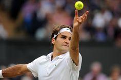 Roger Federer begins his serve motion during the semi-final match against Novak Djokovic. - Neil Tingle/AELTC