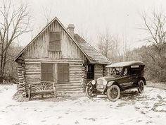 Two women in new Oldsmobile in front of log cabin, Rock Creek Park, Washington, D.C.; picture made for Oldsmobile Sales Co. It was made in 1920.