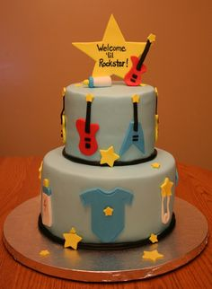 For a Rock Star themed baby shower.  All fondant accents, gumpaste star and guitars. I also made matching cupcakes.