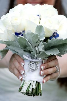 White rose bouquet with sage green leaves, something blue, pearl accents, and a photo locket. Desmond Charles Photography