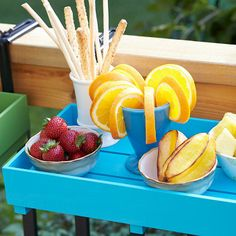 A deck never has enough surfaces for serving or prepping food. These easy-to-make wooden trays rest on deck rail hangers and can move from rail to table to kitchen and back. Just lift the tray from its hanger and carry it where you need it.  #SpringIsCalling