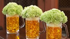 Get a beer mug and fill it with yellow or gold coloured rocks or gems you would find in a specialty or craft store. Line the top of the mug with white paper or felt, and then place short stemmed flowers in the top of the mug! Super cool decoration!