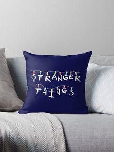 """Stranger Things"". You recognize this from Will's Mother's Wall! For who loves Eleven (Millie Bobby Brown), Mike (Finn Wolfhard), Dustin (Gaten Matarazzo), Lucas (Caleb McLaughin), Will (Noah Schnapp), Joyce (Winona Ryder), Chief Hopper (David Harbour). #strangerthings, #netflix #strangerthingsfan #nerd #geek #friendsdontlie #eleven #mike #dustin #lucas #chiefhopper #hawkins #upsidedown #dungeonsanddragons #pillow #homedecor #decor #interiordesign #home Eleven St, Stranger Things Lights, Geek Decor, Xmas Lights, White Throw Pillows, Geek Girls, Millie Bobby Brown, Geek Stuff, Winona Ryder"