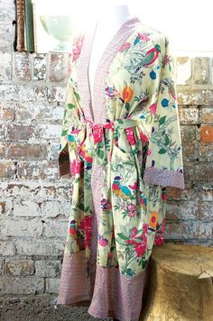 Elegantly enchanting, our Songbird & Fleur Kimono inspires rest and calming relaxation with the serenity of nature. Made from the softest slightly sheer cotton fabric with flower and feathered bird patterning, this comfortable kimono style robe features roomy sleeves and a matching tie at the waist. Robe is women's one size fits most and comes gift wrapped in a hand crafted wood crate with ribbon.     ONLINE ORDERS - LIMITED TIME SPECIAL  FREE STANDARD SHIPPING!