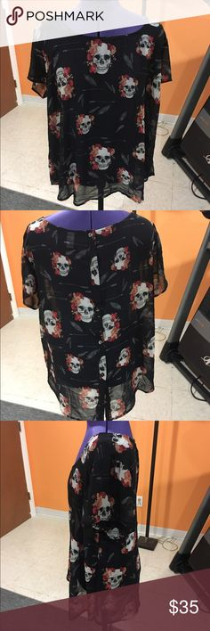 Sheer skill shirt Sheer black skull shirt with flowers, arrows and feathers. Has buttons down the back of the shirt with a slit. In great condition. Very cute!! Feel free to make me a reasonable offer!! Torrid size 2 torrid Tops