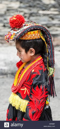 Kalash girl wearing a traditional headdress decorated with cowrie Stock Photo, Royalty Free Image: 112660331 - Alamy