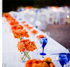 Orange Daisy Centerpieces The low orange centerpieces were inspired by the Blue Orange Weddings, Tangerine Wedding, Orange Wedding Colors, Blue Wedding, Orange Flowers, Wedding Lavender, Orange Wedding Flower Arrangements, Orange Centerpieces, Flower Centerpieces