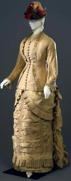 Walking dress, possibly Italian, ca. 1878-80. Two pieces (jacket, skirt) of wool muslin and ecu silk. Costume Gallery of Palazzo Pitti via Europeana Fashion